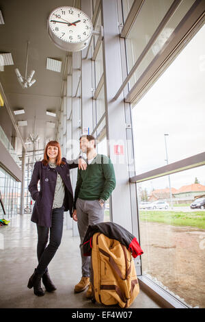 Young couple waiting in airport building - Stock Photo