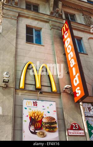 MINSK, BELARUS - September 12, 2012: McDonalds restaurant sign. McDonald's Corporation is the world's largest chain - Stock Photo