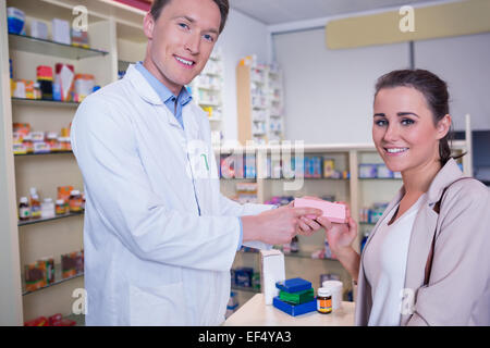 Smiling pharmacist and customer discussing a product - Stock Photo