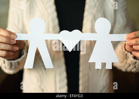 Two paper men with heart shape - Stock Photo