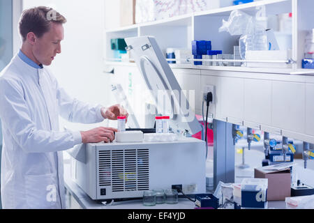 Focused chemist doing an experiment - Stock Photo