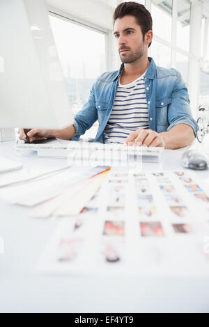 Serious designer using digitizer and computer - Stock Photo