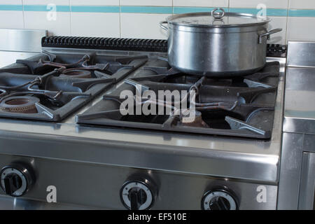 steel large pot over the stove of kitchen in stainless steel - Stock Photo