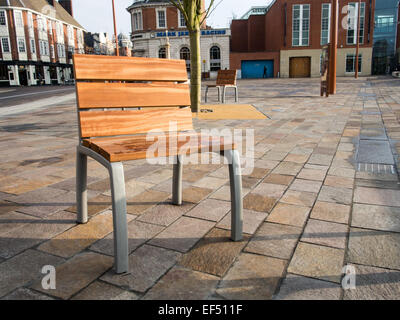 Street Furniture: Wood on metal seating fixed into the granite pavement area of the Jubilee Square, Highcross, Leicester. - Stock Photo