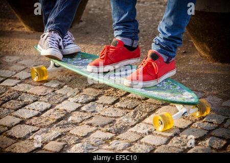 Sports shoes on skateboard - Stock Photo