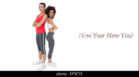 Portrait of two fit young women with arms crossed - Stock Photo