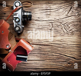 Old rangefinder camera on the old wooden table. - Stock Photo