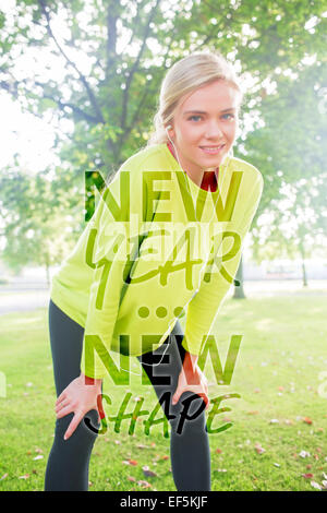 Composite image of active smiling blonde pausing after a run - Stock Photo
