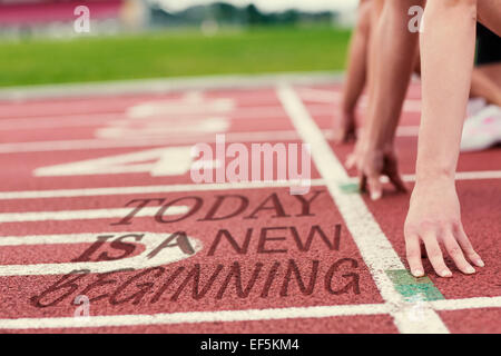 Composite image of cropped people ready to race on track field - Stock Photo