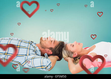 Composite image of attractive young couple sleeping peacefully - Stock Photo