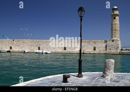 LAMP POST & LIGHTHOUSE ON PIER RETHYMNON CRETE GREECE 02 May 2014 - Stock Photo