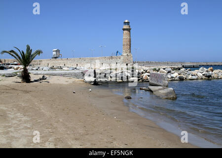 PALM TREES & LIGHTHOUSE ON PIER RETHYMNON CRETE GREECE 02 May 2014 - Stock Photo