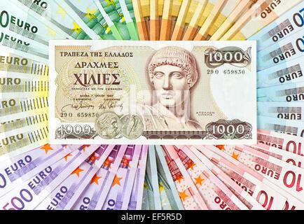 euro crisis concept. old greek drachma and euro cash notes - Stock Photo