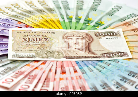 old greek drachma and euro cash banknotes. greece euro crisis concept - Stock Photo