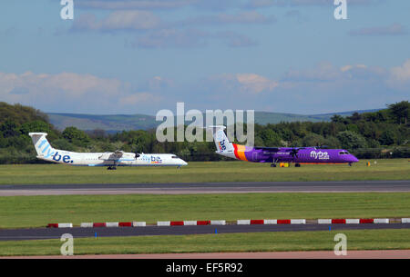 2 FLYBE BOMBARDIER DASH 8 Q400 AIRCRAFT G-ECOR & G-ECOH MANCHESTER AIRPORT ENGLAND 14 May 2014 - Stock Photo