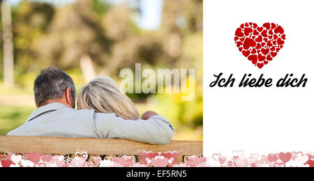 Composite image of cute valentines couple - Stock Photo