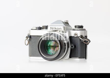 Silver Nikon FE 35mm film slr camera - Stock Photo