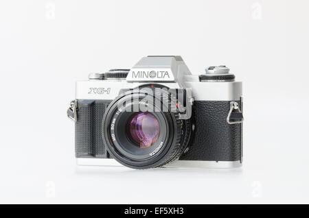Minolta XG-1 35mm film slr on a white background - Stock Photo