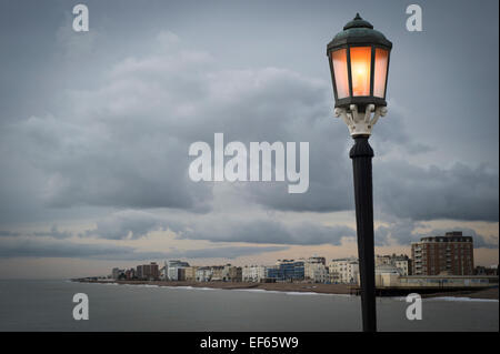 Worthing in West Sussex with illuminated lamp on the pier - Stock Photo