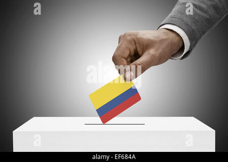 Ballot box painted into national flag colors - Colombia - Stock Photo