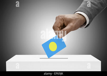 Ballot box painted into national flag colors - Palau - Stock Photo