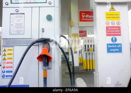 Petrol pumps at a petrol station in the UK. - Stock Photo