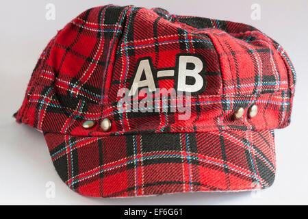 A-B tartan baseball cap isolated on white background - Stock Photo