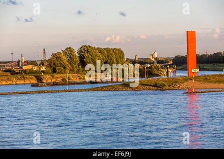 Estuary of the Ruhr and Rhine at Duisburg-Ruhrort, largest European inland port, steel sculpture 'Rhine Orange' - Stock Photo