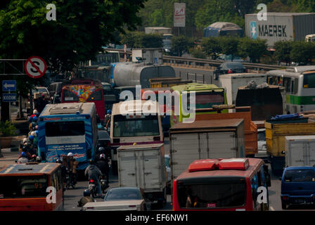 Traffic in Jakarta during mid day. - Stock Photo