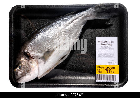 Whole fresh Gilthead sea bream from a supermarket - reduced price, sell-by date reached - Stock Photo