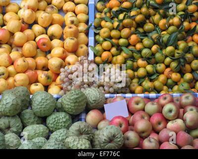 Fresh fruit on market stall - Stock Photo