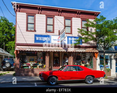 A Pontiac GTO parked outside a hardware store on Main Street in the village of Greenport, Suffolk County, Long Island, - Stock Photo