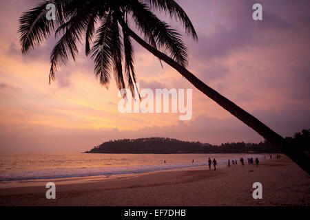 TOURISTS AT SUNSET ON MIRISSA BEACH - Stock Photo