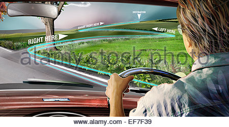 Man driving car using global positioning system - Stock Photo