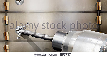 Hole being drilled in door of safe - Stock Photo