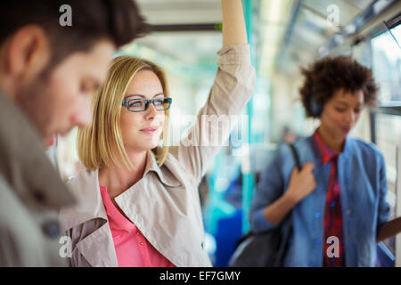 Businesswoman riding train - Stock Photo