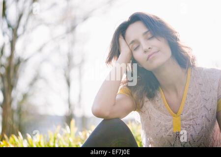 Beautiful woman day dreaming - Stock Photo