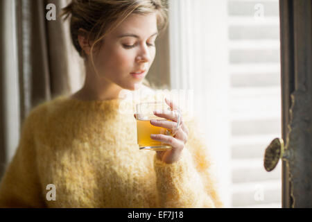 Woman drinking herbal tea - Stock Photo