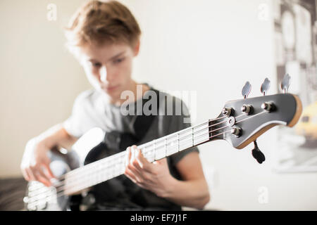 Teenage boy playing a guitar - Stock Photo