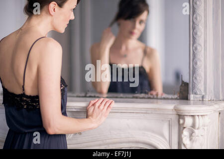Reflection of a woman in mirror