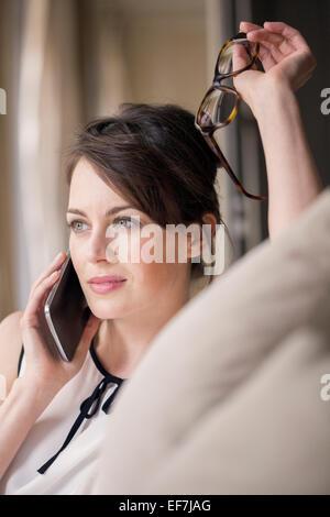 Beautiful woman talking on a mobile phone - Stock Photo