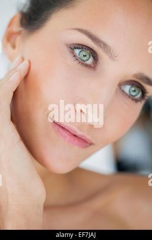 Close-up of a beautiful woman posing - Stock Photo