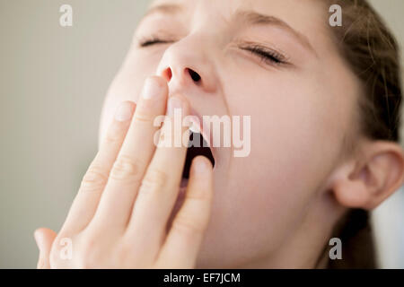 Close-up of a girl yawning - Stock Photo