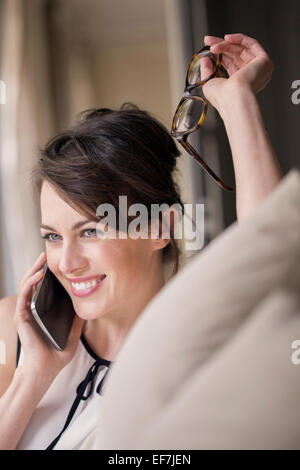 Beautiful woman talking on a mobile phone - Stock Photo
