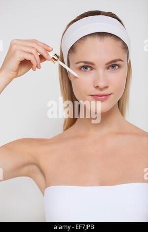 Woman applying mascara - Stock Photo