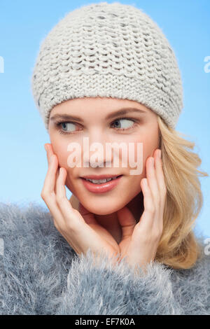 Beautiful woman in knitted hat - Stock Photo