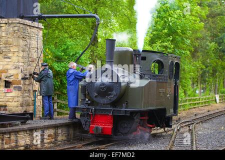 "Steam locomotive ""Thomas Edmondson"" taking on water at Alston Station on the South Tynedale Railway, Alston Station, - Stock Photo"