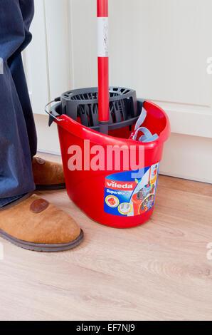 Man Using A Vileda Supermocio Mop & Bucket, UK MODEL RELEASED - Stock Photo