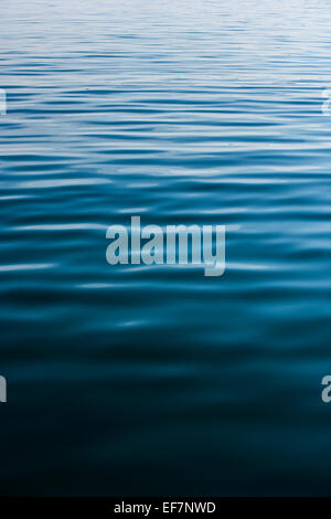 Ripples across dark water - Stock Photo
