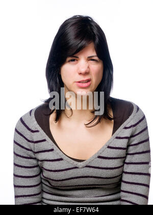 Angry young woman looking threateningly at camera - Stock Photo